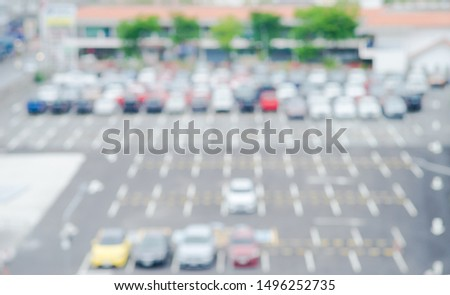 Blurred background of outdoor car park with Bokeh. Abstract blur wallpaper #1496252735