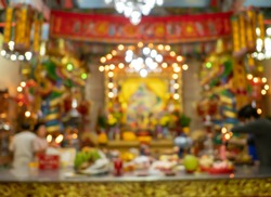 Blurred background of people in Chinese shrine in Chinese New Year festival