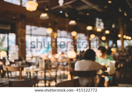 Blurred background of restaurant with people. #415122772