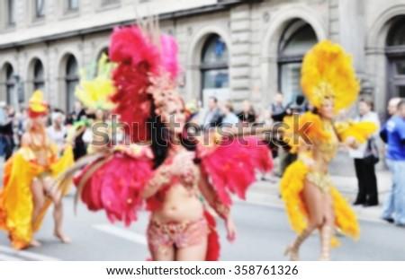 Blurred background of Samba dancers during carnival parade.