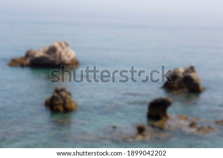 Blurred background of stone riffs near the sea coast. Stock foto ©