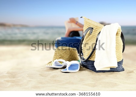 blurred background of summer beach and water of ocean and towels  #368155610