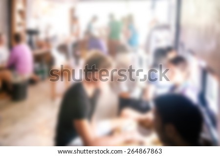blurred background of talking people in coffee cafe