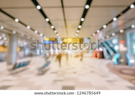 Blurred background of Traveler with baggage walking in the airport,Airline passengers in the airport,passengers rushing at big city station.