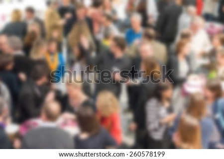 Blurred background of unrecognizable people at a social event