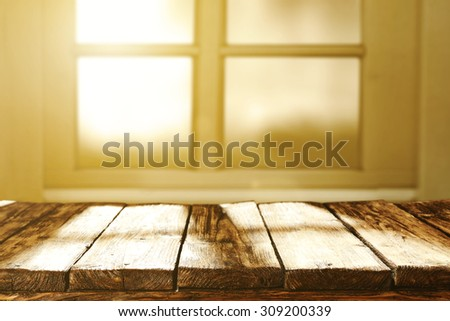 blurred background of window and sun light of morning sun with table