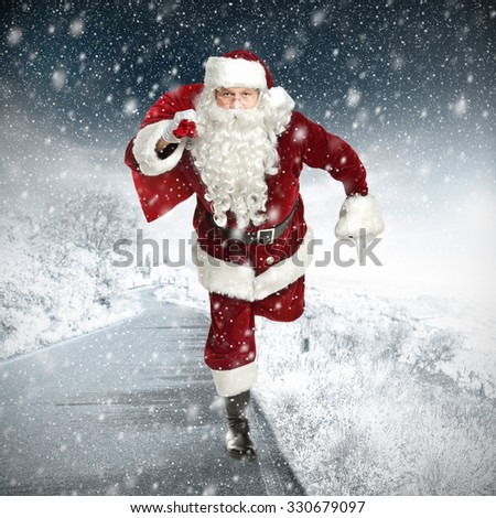 blurred background of winter road of snow and frost with gifts santa claus and xmas time  #330679097