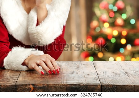 blurred background of xmas tree in home and table and woman
