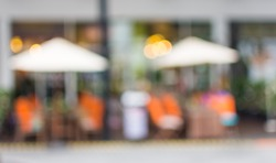Blurred background : Outdoor restaurant in mall area abstract blur