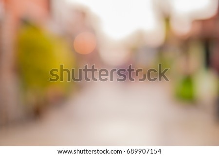 Blurred background : people shopping at market fair #689907154