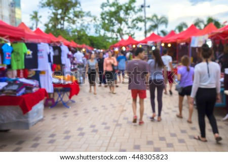 Blurred background : people shopping at market fair in sunny day, blur background with bokeh. in Lao market