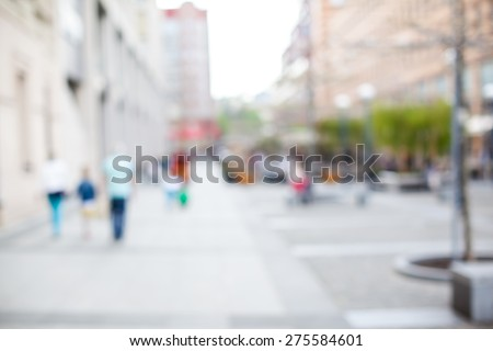 blurred background. people walking on a city street