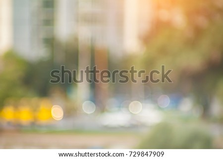 Blurred background photo. Summer blurry city backdrop.