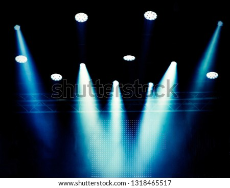 Blurred background, theatrical scene lighting in a haze of blue color during a concert. Banner for design. #1318465517