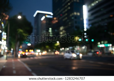 Blurred background, traffic, cars driving on the road and buildings, colorful bokeh, twilight sky, night life in the city, Korea, vintage style