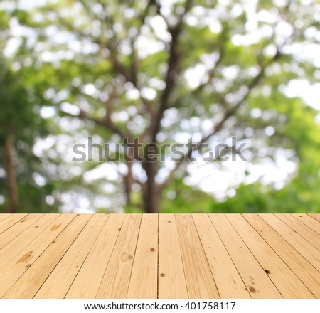 blurred background : tree branch of green leaves and wood floor #401758117