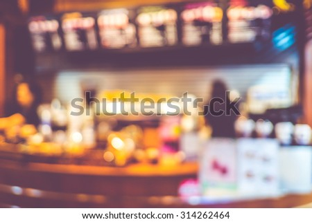 Blurred background : Vintage filter ,Coffee bar with barista at counter in cafe.