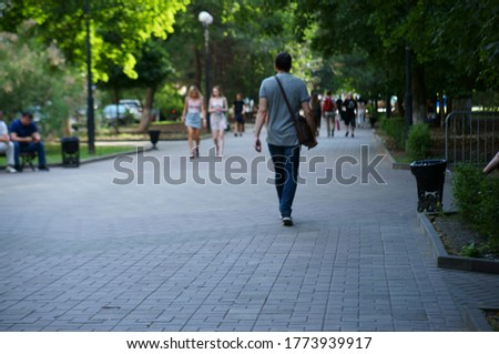 Blurred background. Walk along the city street. Man in town