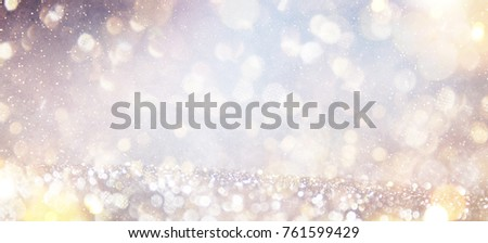 Blurred background with bokeh. Christmas and Happy New Year greeting card. #761599429