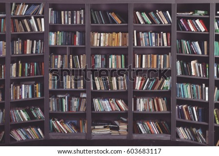 blurred background with bookshelf. vintage picture