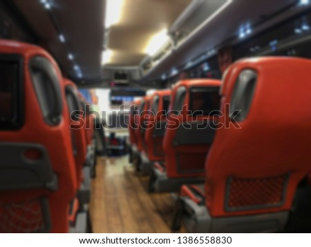 blurred background with inside of a public bus #1386558830