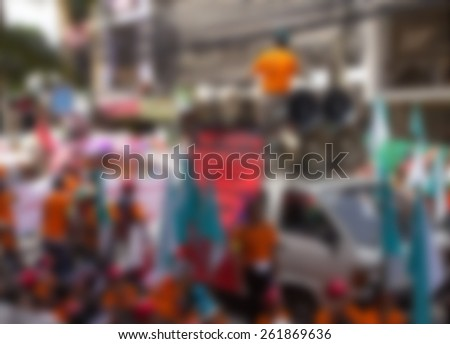 Blurred background with protesters gathered on the road #261869636