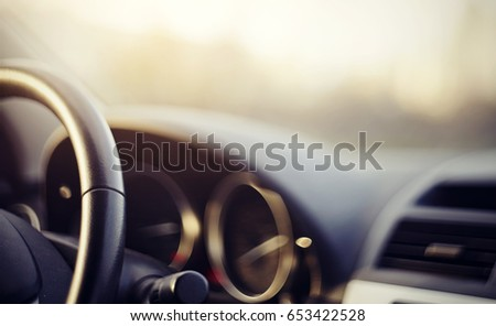 Blurred background with the dashboard of the car #653422528