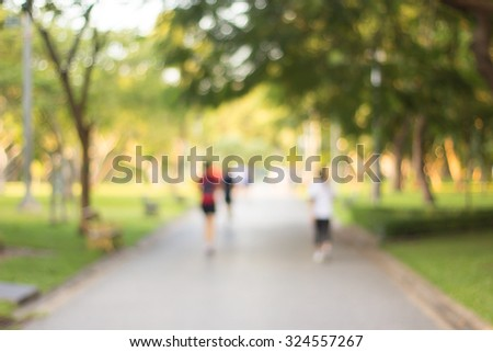 blurred backgrounds of people exercise at parks outdoor:blur of people running,walking,jogging at park:blur of nature park outdoor:blur and out of focus concept:blurred of sport and activity concept.