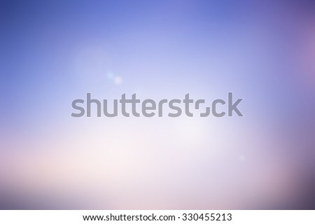 blurred backgrounds of sea with flare lights.blurred backgrounds concept:blur of sunset sky wallpaper backdrop:pastel tone styles colours.spring and summer concept.
