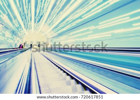 Blurred backround of moving futuristic escalator. Blurred image.Post process in vintage style #720617851
