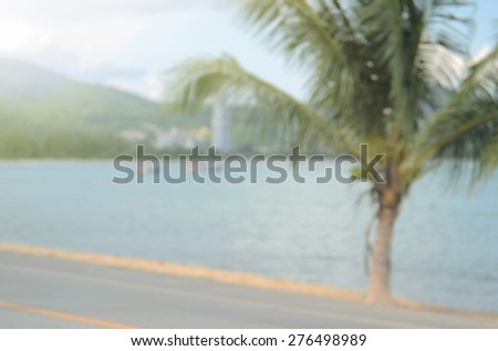 Blurred beach road with palm tree abstract background.