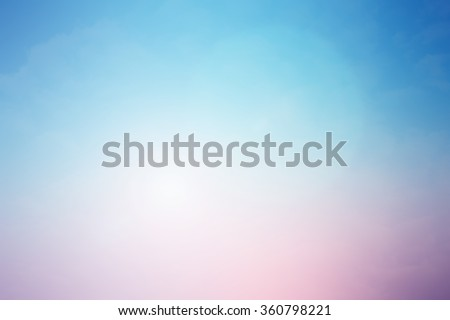 blurred beautiful natural landscape background with ray flare lights.blurry sunshine wallpaper concept.backdrop pastel tone.idyllic shores sundown hours.abstract dream magic coastline dramatic image.
