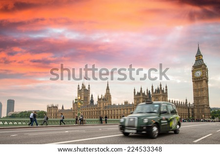 Blurred black taxi cab moving on Westminster Bridge London