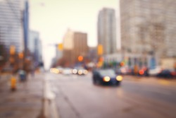 Blurred blurry soft focus background, busy downtown street with cars and lights, urban city life concept