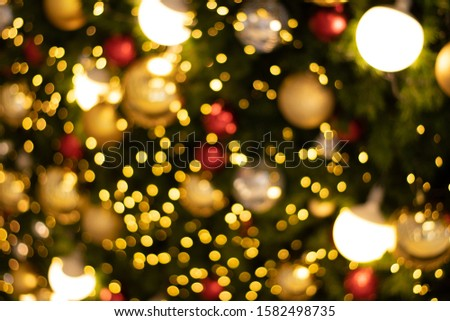 blurred bokeh decorated christmas tree on background. blurred bokeh background. blurred bokeh merry christmas and New Year holidays background