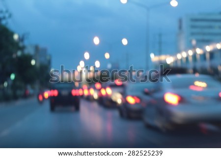 blurred bokeh of car in city at ...
