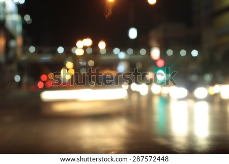Blurred bokeh of car in city at night #287572448
