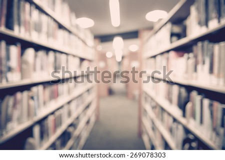 Blurred books in public library. Blur effect. Background.