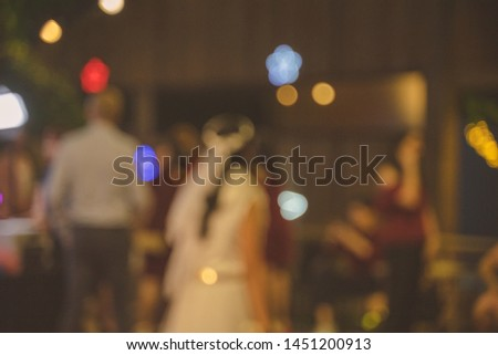 Blurred bride with blurred light as bokeh. Noised image #1451200913