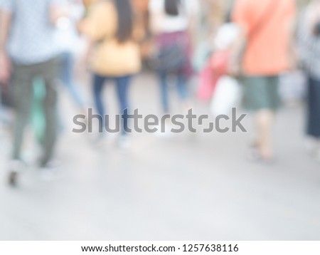 Blurred bright background, Tourists people walking on the local city street, shoot from behind #1257638116