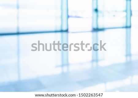 BLURRED BRIGHTLY CLEANED FLOOR IN MODERN BUSINESS OFFICE, LIGHT INTERIOR BACKGROUND #1502263547