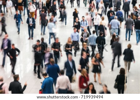 Blurred business people crowd at a trade fair