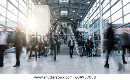 blurred business people in a modern hall #604959038