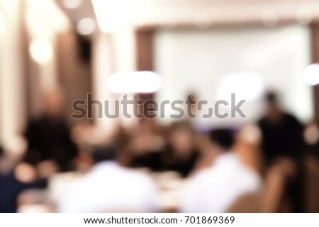 Blurred business people sit stand walk working in conference room #701869369
