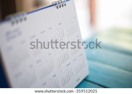 Blurred calendar page blue background. #359512025