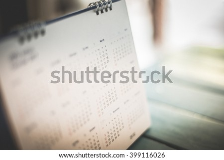 Blurred calendar page dark tone #399116026