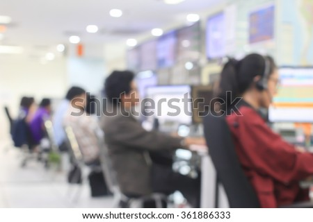blurred call center of network operator work monitoring on computer at office room.