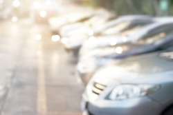 Blurred car parking in the sunset for background