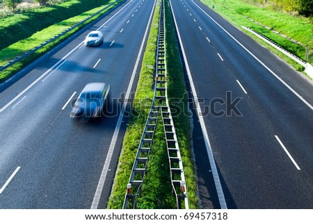 Blurred cars on highway traffic