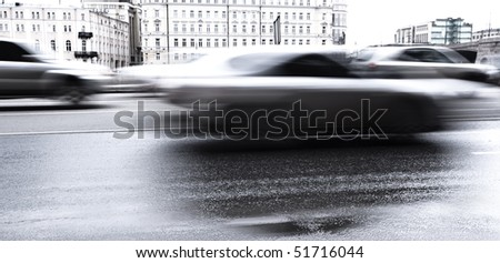 Blurred cars on the city road